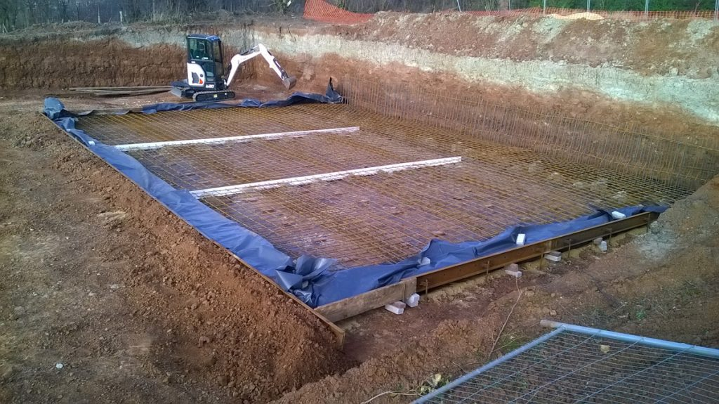 Setting out the base slab steel